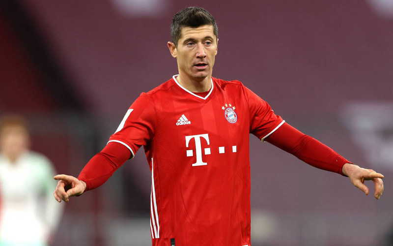Robert Lewandowski with his own collection of sports clothes
